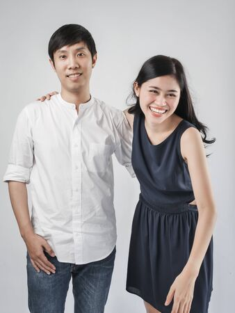 Asian couple hugging together with white background.