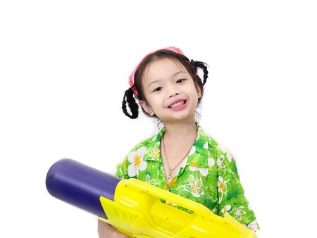 Young Asian girl with water gun on white background, Songkran Festival concept.