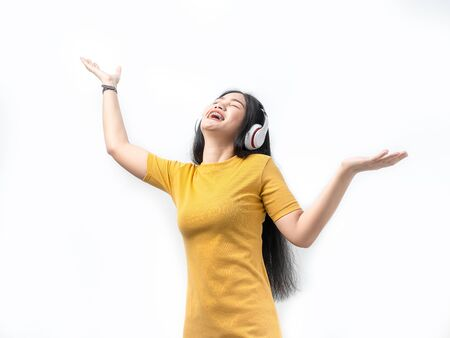 Happy Asian woman using headphone on white background, lifetyle concept.