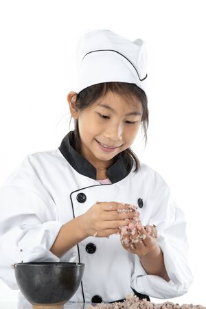 Asian girl learning how to making sushi on white background 写真素材