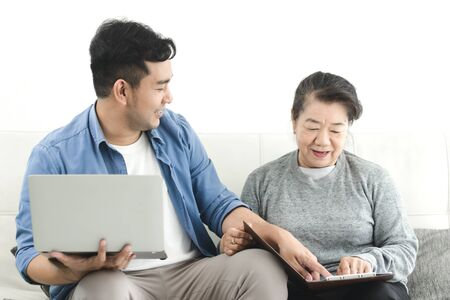 Asian agent man deal with senior for life insurance contract signed, business concept.