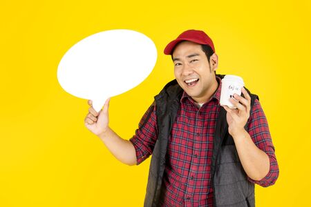 Delivery man is carrying diverse of paper containers for takeaway food and drink and blank speech bubble on yellow background.