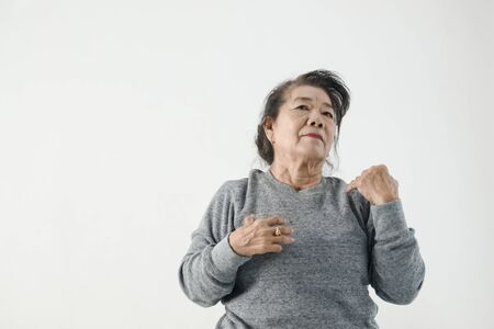 Asian senior woman doing exercise and dancing at home, stay home lifestyle concept.