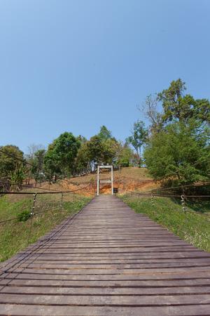 Adventure wooden rope suspension bridge photo