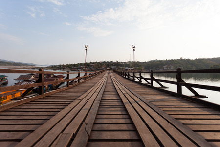 Raft house village floating and wooden bridge photo