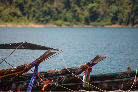 thani: small boats in the Ratchapapha dam Surat Thani province Thailand.