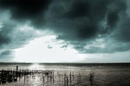 Black clouds hiding the sun.