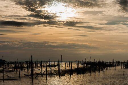 Golden sun shining Kachag sea full of fish fishermen. photo