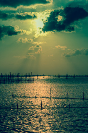 Sunset, the District North Island, North Lake Songkhla is putting family fishing nets. photo
