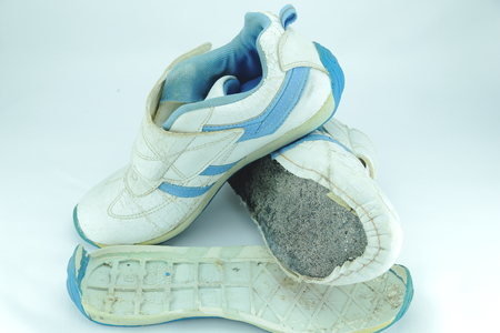 discard: Old shoes and active wear for a long time Stock Photo