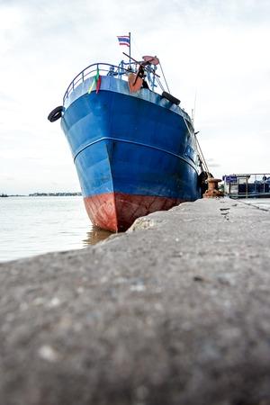 commercial docks: Docks, cargo ships and fishing boats at Lake Songkhla. Stock Photo