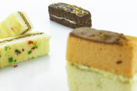yule log: fruit cake on white background Stock Photo