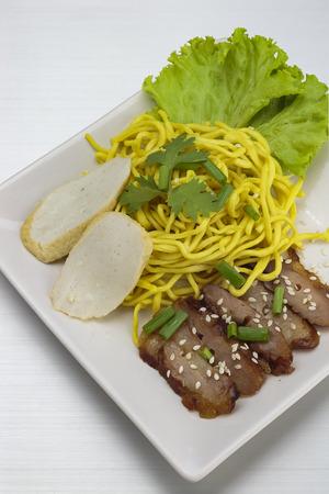 Dry yellow noodle thai food on  Aluminum bronze