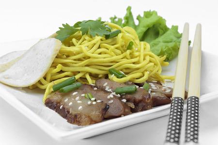 Dry yellow noodle thai food on white background Stock Photo