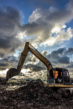 Excavator operator downtime waiting. Stock Photo