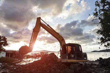 Excavator operator downtime waiting sunset