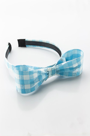 elastic band: Blue and white headband on white background