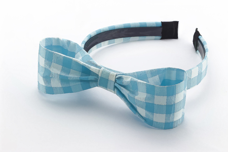 Blue and white headband on white background