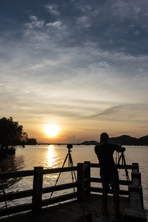 silhouette photographer Nature and sunset