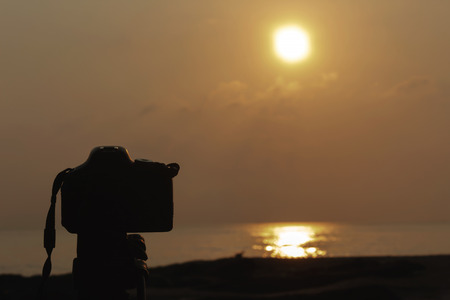 silhouette, camera and nature by the sea.