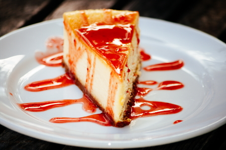 Strawberry cheese cake on the white plate