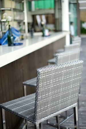 Beautiful elegant interior design, bar counter top with ratan chairs