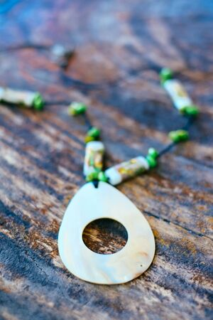Hand made beautiful necklaces mede from abalone shell and coral beads Stock Photo