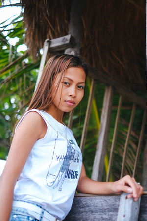 Portrait of beautiful Asian girl posing on the tree house