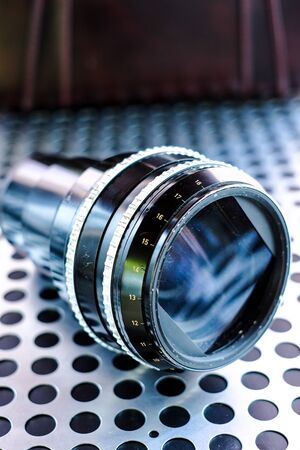 metalic: Vintage professional projection movie lens on metalic background