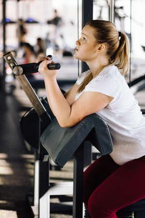 Beginner girl exercising in fitness gym Stock Photo
