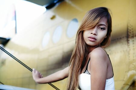 Beautiful female portrait on the airfield,late afternoon Stock Photo