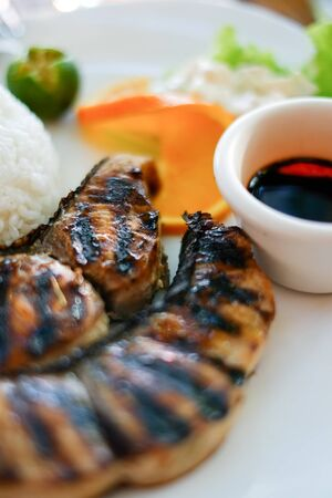 prepared: Barbecued, grilled Fish stake Asian style with rice and soy souse, shallow focus