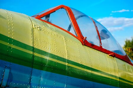 airplane ultralight: Cokpit detail of colorful airplane on the grass of the airfield