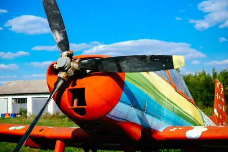airplane ultralight: Colorful airplane on the grass of the airfield