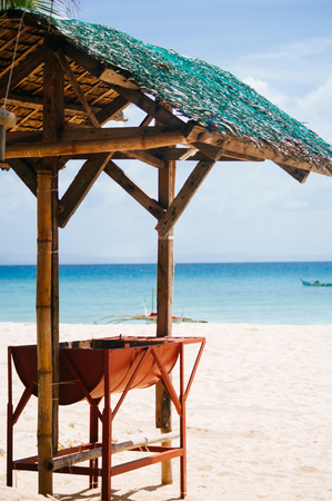 bathe: Barbecue under the shed on white sand beach