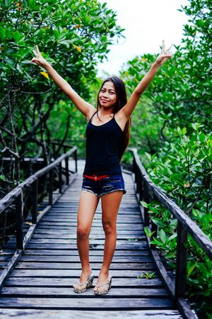 foot bridges: Young beautiful girl portrait on the wooden bridge in the mangrove forest
