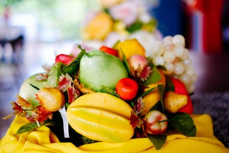 Basket filled with plastic fruits as interior decoration
