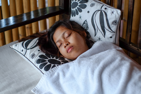 balcony: Young Asian woman sleeping peacefully in the bacony during summer vacation Stock Photo