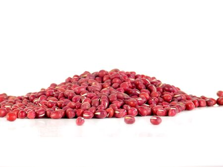 vigna: Red adzuki beans, also called azuki, aduki or Red Mung Bean. Dried small beans of Vigna angularis. Isolated macro food photo close up on white background Stock Photo