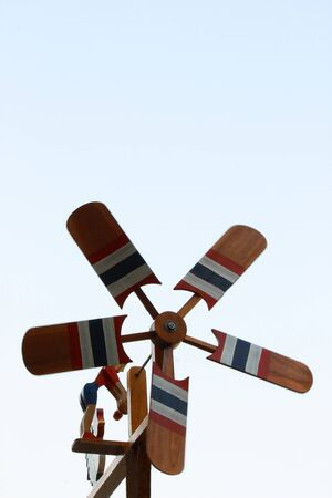 Small Wood Windmill in blue sky photo