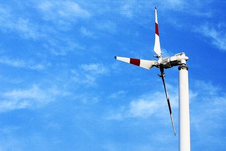 Windmill on the blue sky photo