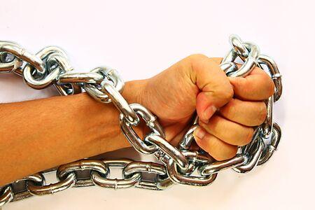 ็Hand holding metal chain photo
