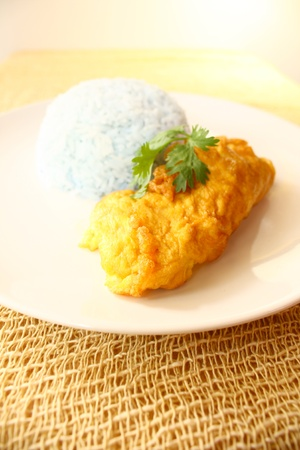 Delicious omlette with rice cooked with butterfly pea photo