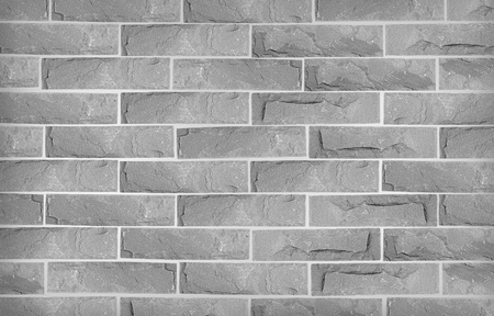 Grunge grey stone brick wall photo