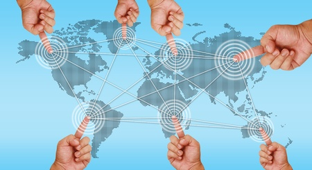 continents: hand pointing on continents and link together Stock Photo