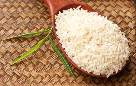 Raw rice with bamboo leaf in wood tray