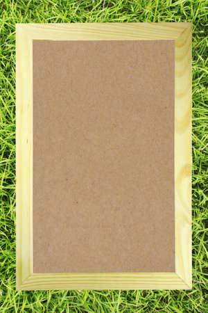 Brwon blank paper in wood frame