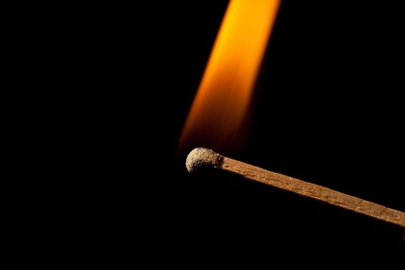 Burn match with flame photo