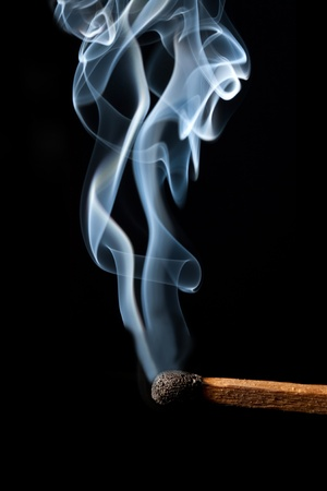 Burn match with abstract smoke photo