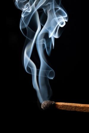 Burn match with abstract smoke Stock Photo
